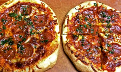 Two beautiful pizzas